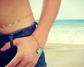 turquoise cross hand jewelry. slave bracelet. hand chain