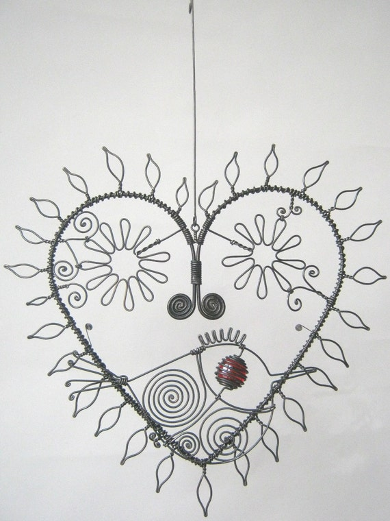 Wire Heart Sculpture With Leaves And Flowers And A Bird For