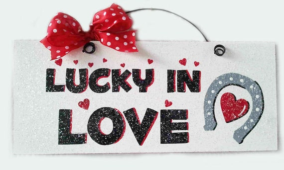 "Valentine's Day Sign with glitter ""Lucky in Love""."