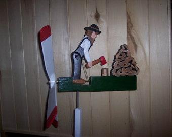 Whirlygig. man chopping wood whirlygig