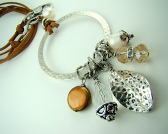 Long brown leather necklace, pearl and crystal charm necklace, hammered silver pendant... Boho Chic