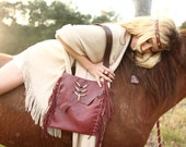 the vagabond. oxblood leather fringe bag. spellbound collection