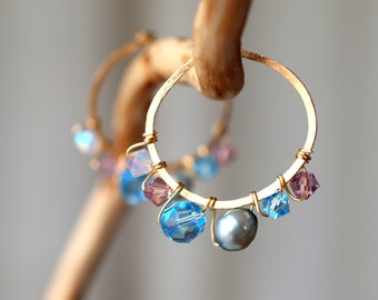 Gold filled hammed hoop wirewrapped in baby blue and pink swarovski crystals