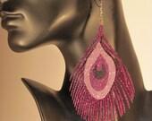 Purple glitter peacock feather earrings