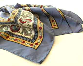 """Vintage silk scarf. Large, square, denim blue ground with floral print and colorful geometric border. 34"""" square."""