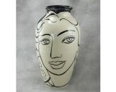 Black and White Face Vase....