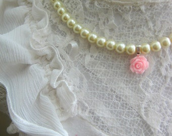 Glass pearl rose necklace.