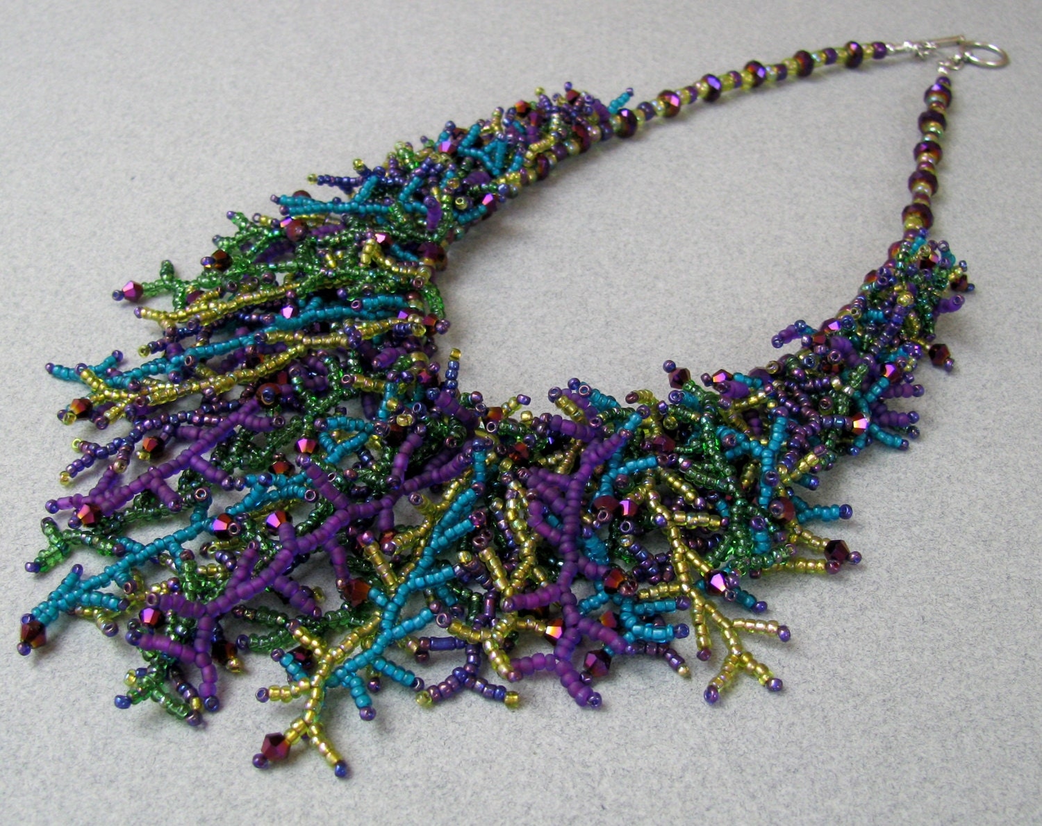 items similar to peacock seed bead and fringe necklace on etsy