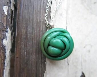 vintage celluloid button necklace. peas