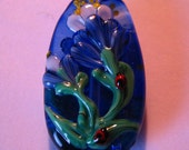 Skholtglass Blue & White Flowers and Ladybugs 2-sided Lampwork focal bead--Signed