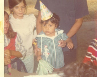 First Birthday Boy in Party Hat and Seahorse Romper Holding Toy Cake Vintage 1970s  Color Photo Photograph