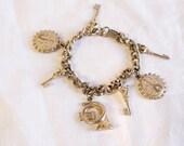 Vintage charm bracelet with musical instruments and skeleton keys