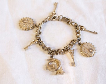 Vintage charm bracelet with musical instruments and skeleton keys