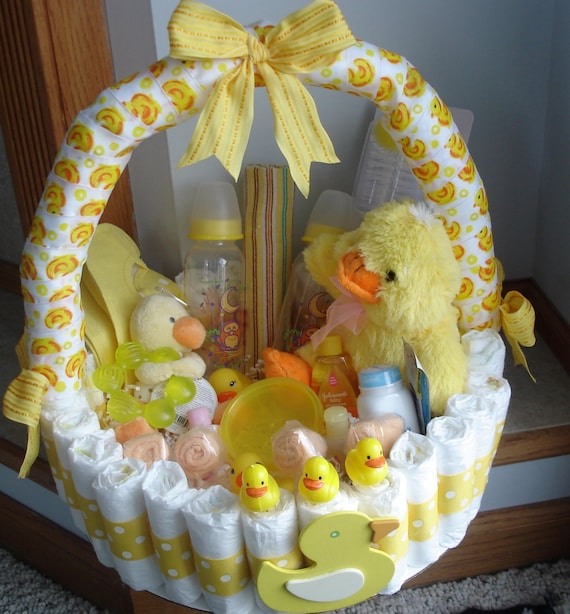 Duckie diaper basket baby shower centerpiece by teresaphillips for Baby shower diaper decoration game