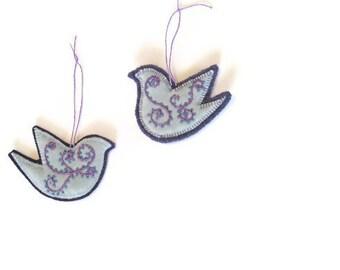 Bird pair ornaments/embroidered aqua velvet on purple felt