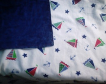Two sided Flannel Blanket with Sail Boats in Blue, Green and Red on top and Marbled Blue on back