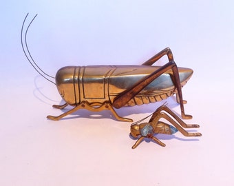 Vintage pair of brass grasshopper crickets.  Large and small.