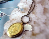 gold locket with elepant cirlcle ring dnalge shell long chain antique bronze necklace