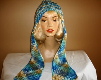 Hat with long earflaps in blues and tan