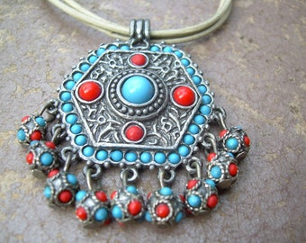 Beautiful Faux Coral and Faux turquoise Ethnic Bohemian style necklace with dangle charms