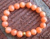 Orange Jade Stretch Stacking Bracelet With Gold Spacer Beads