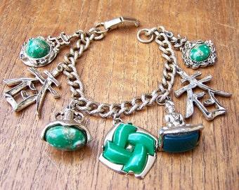Vintage Asian Theme 7 Charm Bracelet Green Plastic Unsigned