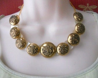 Crested button necklace