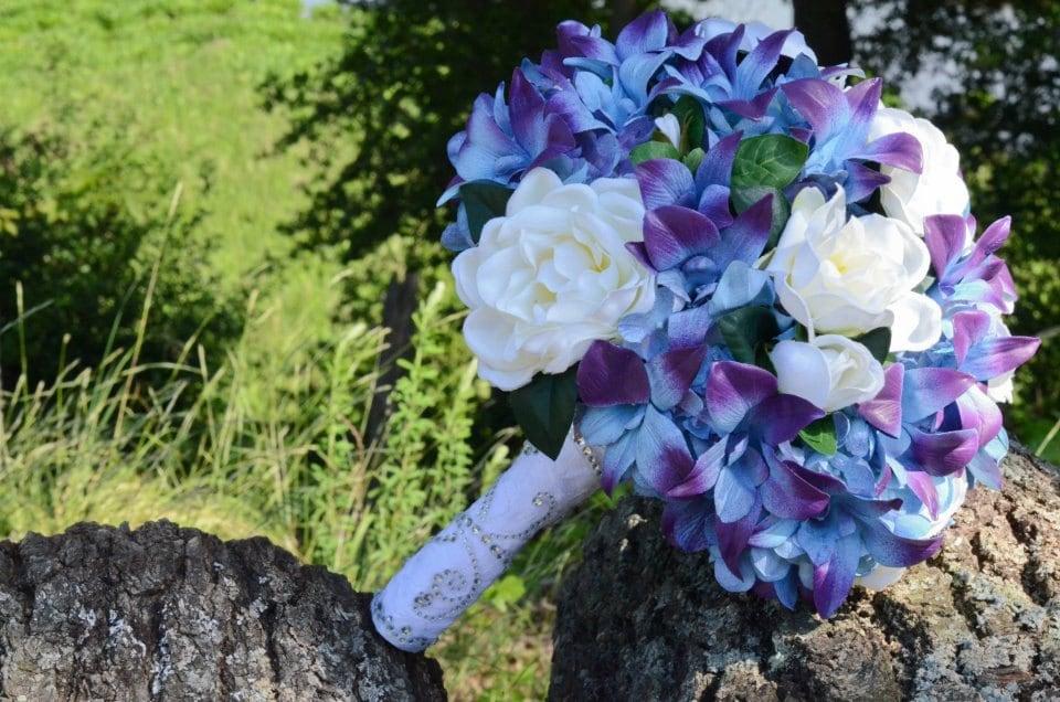 Blue dendrobium orchids blue purple viburnum and white