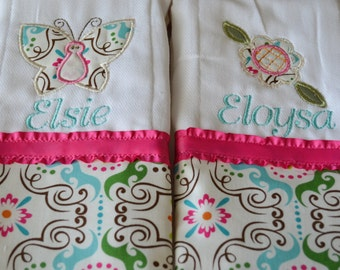 set of 2 personalized monogrammed burp cloths in teal and pink flower and butterfly