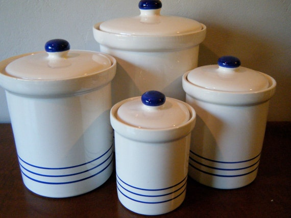 Set 4 white eartenware kitchen canisters with blue stripes for Blue kitchen set