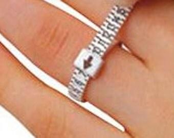 ring sizer, plastic, adjustable