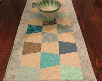 Quilted Tumbler Table Runner in greens, teal, and ecru