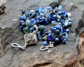 blue hues. lapis lazuli bracelet. tibetan focal bead / beaded wire wrapped dark blue beaded uniquenecks bracelet