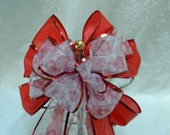 Valentine Bow Sheer ribbon with red and pink hearts and I love you  printed on it  on red ribbon with red metallic edge