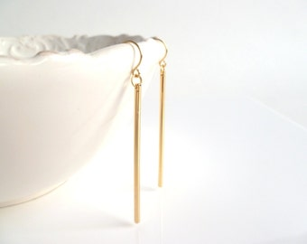 Gold line earrings - long thin straight polished sticks dangle from little simple gold hooks - modern minimalist and elegant