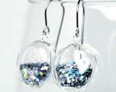 Silver iridescent glitter round blown glass dangle earrings.