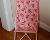 Doll Stroller Seat made from strawberry shortcake fabric