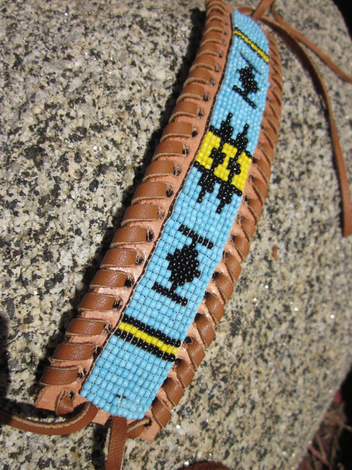 loomed indian seed beaded bracelet on woven leather cuff