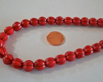 Red Melon Shaped Bead Strand