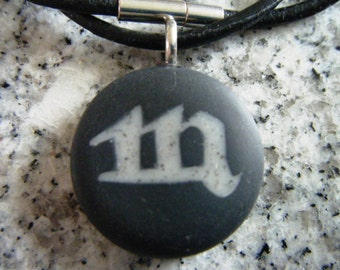 Scorpio Zodiac signs hand carved on a polymer clay black color background. Pendant comes with a FREE 3mm necklace.
