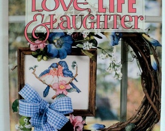 Love, Life & Laughter Counted Cross Stitch Patterns - Soft Cover Book - Leisure Arts Best