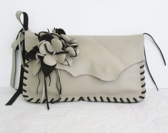 Brown suede, taupe tan leather wristlet clutch with fringe and flower by Tuscada. Ready to ship.