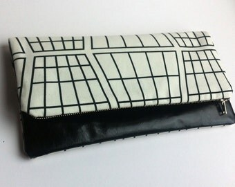 Leather clutch bag with monochrome print fabric