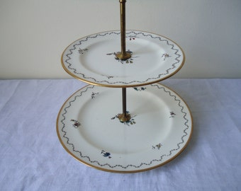 vintage two-tiered ceramic cake stand by Johnson Bros England