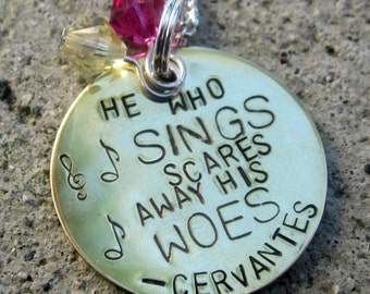 Cervantes Quote - He who sings scares away his woes - Hand Stamped Necklace