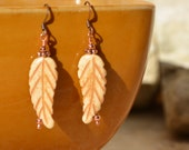 Carved Bone Feather Earrings.............................item number 334