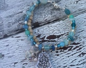 Peaceful Warrior Yoga/Hamsa Bracelet - silver, sandlewood and aqua glass beading with Hamsa symbol and signature woven bead charm