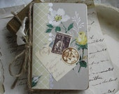 small moleskine blank journal book, yellow roses vintage wallpaper, decoupaged french stamps.