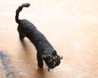 Black knitted cat