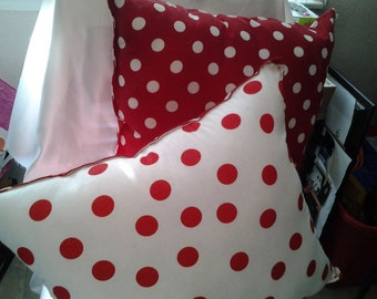 two red and white polka-dot pillows